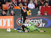 D.C. United defender Robbie Russell (3) goes against Seattle Sounder midfeidler Brad Evans (3)  D.C. United tied The Seattle Sounders 0-0 at RFK Stadium, Saturday April 7 , 2012.