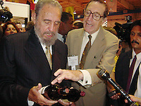 HAVANA, CUBA-SEPTEMBER 26 Cuban president Fidel Castro (L) talks with Peter Nathan of PWN Exhibicon International LLC, on September 26, 2002, during his visit to the Fair of Agricultural and North American managers' Cattleman. A group of top American food and agricultural executives with some 280 companies from 33 states hope to recover a lost market for U.S. food products as they push for further lifting of sanctions imposed on Cuba after Fidel Castro's 1959 revolution. Cuban officials expect to sign hundreds of contracts at the five-day food fair to attract more U.S. interest and encourage growing political support for legislation now before the U.S. Congress to lift a ban on American tourists going to Cuba. . Credit: Jorge Rey/MediaPunch