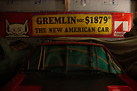 Reinholds, Pennsylvania, February 10, 2015 - An original AMC sign and  a one-of-a-kind 1974 Gremlin XP, a second generation 2 prototype never released, and which was originally owned by Richard Teague, the design chief at AMC and one of the cars inventors, in one of the garages of Brian Moyer. <br /> <br /> Moyer owns 16 AMC Gremlins. The Gremlin was introduced on April Fools Day (April 1) in 1970 featuring a shortened Hornet body with a Kammback tail and was manufactured in the US via AMC and in Mexico via AMC's subsidiary VAM. It's lifecycle ended in 1978 when it was replaced by the AMC Spirit. Moyer became interested as a kid when he saw the early Gremlin commercials in 1970. His first car was a Gremlin and he has never not owned one. Today he has arguably the most unique collection of Gremlins in the world, including several that are one-of-a kind models. <br /> <br /> CREDIT: Daryl Peveto for The Wall Street Journal<br /> Photo Assignment ID: 36892 <br /> Slug: MYRIDE_Gremlin