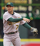 Oakland Athletics second baseman Adam Rosales watches his throw to first base against  the Seattle Mariners in the opening home game of the season at SAFECO Field in Seattle April 12, 2010. The Athletics beat the Mariners 4-0. Jim Bryant Photo. &copy;2010. ALL RIGHTS RESERVED.