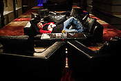 A Chinese man takes a nap in the private part of the hotel lobby of the Galaxy Macau Hotel in Macau, China.