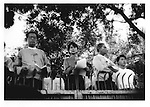 1996: The people's champion.  Aung San Suu Kyi delivers speech from a platform set up behind the front gate at her Rangoon (Yangon) home, Burma (Myanmar).  She is now under house arrest at this location.