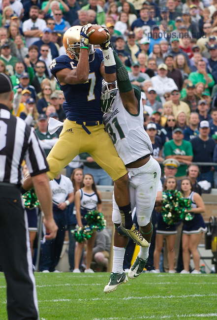 Sept. 21, 2013; Irish wide receiver TJ Jones (7) catches a touchdown pass as Michigan State Spartans cornerback Darqueze Dennard (31) defends in the second quarter.