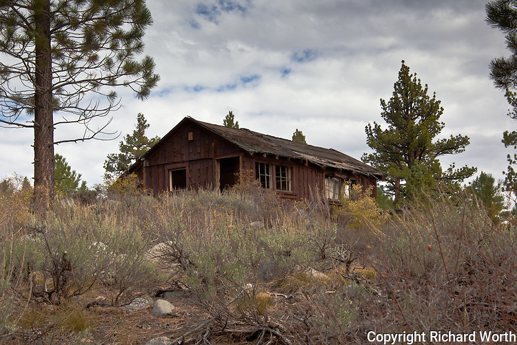 Large enough to have been a home, this abandoned and decaying building will soon be buried in Sierra Nevada snow.  And not for the first time.