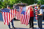 Aug. 18, 2012 - Farmingdale, New York, U.S.: Members of Patriot Guard Riders carefully roll up American Flags after burial ceremony of Marine Lance Corporal Greg Buckley Jr, 21 - the Oceanside native killed in Afghanistan 9 days earlier - at Long Island National Cemetery.