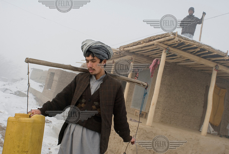 A man ventures out to collect water during the harshest winter Afghanistan had seen in 15 years.