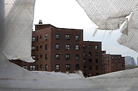 Housing project in Harlem seen from Kalahari construction site on April 28, 2007. (© Frances Roberts)
