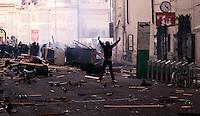 Roma 14 Dicembre 2010.<br /> Manifestazione contro il Governo Berlusconi. Un manifestante fronteggia la polizia e mima il gesto della pistola in via del Corso.<br /> Rome December 14, 2010.<br /> Demonstration against the Berlusconi government. Protesters attack police.