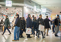 Hordes of last minute shoppers crowd the Queens Center Mall in the borough of Queens in New York on Christmas Eve, Saturday, December 24, 2016. A study reports that the holiday shopping season, November and December, now accounts for less than 21 percent of physical stores' sales, down from its peak of 25 percent. (© Richard B. Levine)