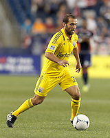 Columbus Crew forward Federico Higuain (33) on the attack. In a Major League Soccer (MLS) match, the New England Revolution defeated Columbus Crew, 2-0, at Gillette Stadium on September 5, 2012.