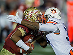 Commissioned by United Press International<br /> <br /> Auburn defensive end Dee Ford (30) meets face to face with FSU quarterback Jameis Winston in the first half of the BCS national title game at the Rose Bowl in Pasadena, California on January 6, 2014.