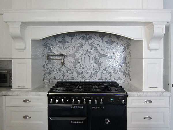 This custom kitchen features a handmade Kingston Lacy mosaic backsplash shown in Calacatta Tia and Bardiglio by Rogers &amp; Goffigon for New Ravenna.<br /> <br /> For pricing samples and design help, click here: http://www.newravenna.com/showrooms/