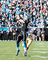 The Carolina Panthers played the San Francisco 49ers at Bank of America Stadium in Charlotte, NC in the NFC divisional playoffs on January 12, 2014.  Carolina Panthers tight end Greg Olsen (88) catches a pass over San Francisco 49ers defensive back Perrish Cox (20).