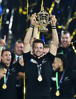 Richie McCaw of New Zealand lifts the Webb Ellis Cup in celebration as his team are crowned World Champions. Rugby World Cup Final between New Zealand and Australia on October 31, 2015 at Twickenham Stadium in London, England. Photo by: Patrick Khachfe / Onside Images