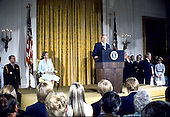 United States President Gerald R. Ford makes remarks after being sworn-in as President at the White House in Washington, D.C. on August 9, 1974.  Ford was the first person to serve as President who had not been elected.  First lady Betty Ford is seated at left.<br /> Credit: Arnie Sachs / CNP