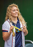 25 August 2016: 2016 Olympic Gold medal winner for the USA in women's wrestling, Helen Maroulis shows off her hardware prior to a game between the Baltimore Orioles and the Washington Nationals at Nationals Park in Washington, DC. The Nationals blanked the Orioles 4-0 to salvage one game of their 4-game home and away series. Mandatory Credit: Ed Wolfstein Photo *** RAW (NEF) Image File Available ***