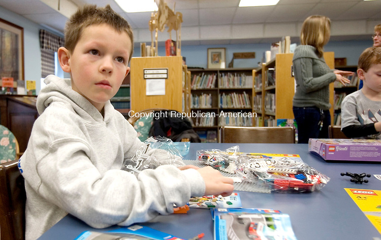 BETHLEHEM CT. 15 February 2014-021514SV05-Griffin Blum, 6, of Bethlehem tries to decide on his design during the Lego Club at the library in Bethlehem Saturday. The program is funded by a grant from Thomaston Savings Bank and is open to all school-aged children. <br /> Steven Valenti Republican-American