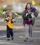 A women and her son bring flowers to put next to a memorial near the scene of a shooting that killed four Lakewood Police Officers in Lakewood on Sunday, Nov. 29, 2009.  At about 8:00 this morning, a gunman walked into the Fornza Coffee shop while the four police officers were having coffee before their shift started and opened fire, killing all our law enforcement.  Jim Bryant Photo. ©2010. ALL RIGHTS RESERVED.