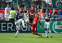 07 August 2010: Toronto FC forward Maicon Santos #29 battles with Chivas USA defender Dario Delgado #12 and Chivas USA defender Michael Umana #4 during a game between Chivas USA and Toronto FC at BMO Field in Toronto..Toronto FC won 2-1.