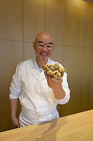 Sushi chef Mitsuhiro Araki holding a white truffle. The Araki, London, UK, December 16, 2014. Following the success of his Three-Michelin-Star restaurant in Tokyo's Ginza, in 2014 Araki relocated to London.