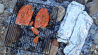 NWA Democrat-Gazette/FLIP PUTTHOFF <br /> Salmon, potatoes and carrots Oct. 17, 2015 on the campfire coals.