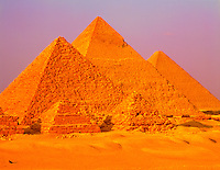 Sunset at the Pyramids of Khufu, Khafre, Menkaure, and the Small Pyramids of Queens, Giza Plateau, near Cairo, Egypt