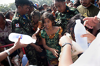 A young Karen girl collects water and food at the refugee centre in Mae Sot. An estimated 20,000 Burmese refugees fled into Thailand to escape clashes in the border towns of Myawaddy and Pyaduangsu, only a day after a Burmese election which critics described as a sham..Ethnic minorities along the Thai-Burma border had warned earlier that the junta would launch a major offensive after the election, as many armed rebel groups had refused to become part of the government-controlled Border Guard Forces.&nbsp;