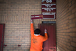 Motherwell 3 Dundee 1, 12/12/2015. Fir Park, Scottish Premiership. A club official putting up an admission price sign above a turnstile at Fir Park, home to Motherwell Football Club, before they played Dundee in a Scottish Premiership fixture. Formed in 1886, the  home side has played at Fir Park since 1895. Motherwell won the match by three goals to one, watched by a crowd of 3512 spectators. Photo by Colin McPherson.