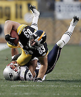 PITTSBURGH, PA - OCTOBER 30:  Heath Miller #83 of the Pittsburgh Steelers dives over an attempted tackle by Patrick Chung #25 of the New England Patriots during the game on October 30, 2011 at Heinz Field in Pittsburgh, Pennsylvania.  (Photo by Jared Wickerham/Getty Images)