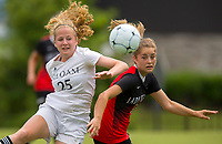 NWA Democrat-Gazette/JASON IVESTER<br /> Siloam Springs junior Megan Hutto (left) and Russellville freshman Megan Flemming go after the ball Friday, May 19, 2017, at Razorback Field in Fayetteville during the 6A state championship game.