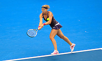 Lucie Safarova of Czech Republic hits a backhand to compatriot Petra Kvitova during their women's singles match at the Sydney International tennis tournament in Sydney, Australia, Wednesday, Jan. 8, 2014. IMAGE RESTRICTED TO EDITORIAL USE ONLY. Photo by Daniel Munoz/VIEWpress