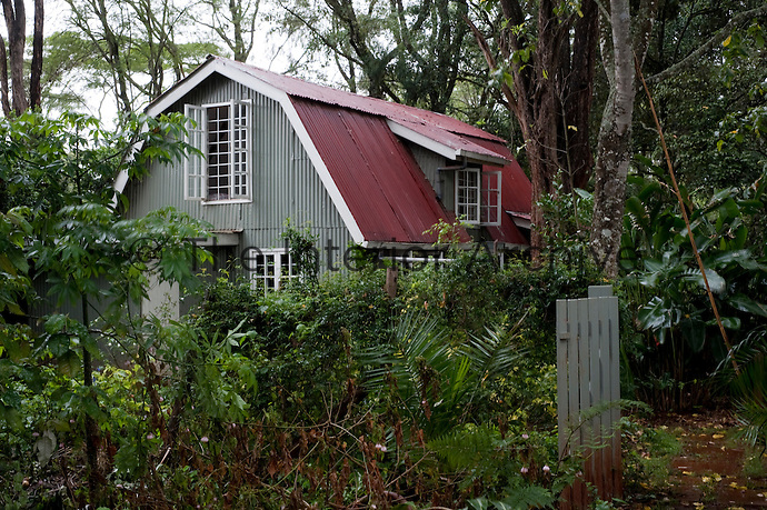 Overnight guests are put up in the corrugated iron guest house in a corner of the garden