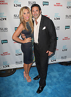 Adrienne Maloof, Paul Nassif.Bravo's Andy Cohen's Book Release Party For &quot;Most Talkative: Stories From The Front Lines Of Pop Held at SUR Lounge, West Hollywood, California, USA..May 14th, 2012.full length black dress suit dress hand on hip grey gray.CAP/ADM/KB.&copy;Kevan Brooks/AdMedia/Capital Pictures.