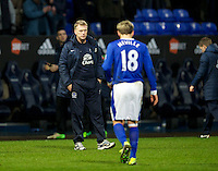 BOLTON, ENGLAND - Saturday, January 26, 2013: Everton's manager David Moyes looks on as an angry captain Phil Neville walks off after abusing fans following his side's 2-1 victory over Bolton Wanderers during the FA Cup 4th Round match at the Reebok Stadium. (Pic by David Rawcliffe/Propaganda)