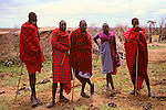 Africa, Kenya, Maasai Mara. The Maasai elders greet visitors to their boma at Olanana in the Maasai Mara.