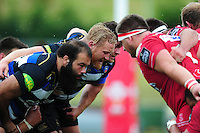 The Bath Rugby front row of Kane Palma-Newport, Ross Batty and Nathan Catt pack down for a scrum. Pre-season friendly match, between the Scarlets and Bath Rugby on August 20, 2016 at Eirias Park in Colwyn Bay, Wales. Photo by: Patrick Khachfe / Onside Images