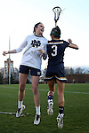 23 February 2017: Notre Dame's Hannah Rees (28) and Nikki Ortega (3). The Elon University Phoenix hosted the University of Notre Dame Fighting Irish at Rudd Field in Elon, North Carolina in a 2017 Division I College Women's Lacrosse match. Notre Dame won the game 16-7.