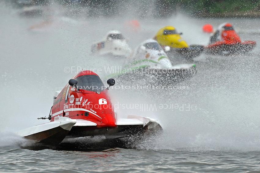 Bud Nollman, (#6) leads a pack through rough water.  (SST-45 class)
