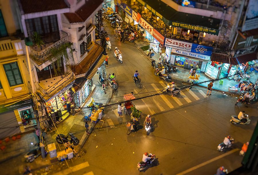HANOI, VIETNAM - CIRCA SEPTEMBER 2014:  Busy corner street in the Hanoi Old Quarter at night in Vietnam.