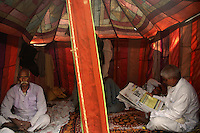 Animal owners take rest in a make shift tent at Sonepur fair ground. Bihar, India, Arindam Mukherjee