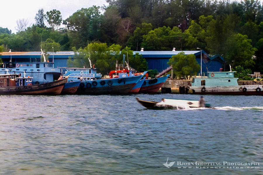 Indonesia, Riau, Batam. Close to Sekupang, a large part of the population still make their living from fishing and sea transport.