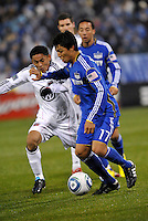 Roger Espinoza (17) holds off Andy Najar...Kansas City Wizards defeated D.C Utd 4-0 in their home opener at Community America Ballpark, Kansas City, Kansas.