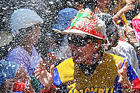 A Colombian man caught in the foam battle during the Carnival in Barranquilla, Colombia, 25 February 2006. The Carnival of Barranquilla is a unique festivity which takes place every year during February or March on the Caribbean coast of Colombia. A colourful mixture of the ancient African tribal dances and the Spanish music influence - cumbia, porro, mapale, puya, congo among others - hit for five days nearly all central streets of Barranquilla. Those traditions kept for centuries by Black African slaves have had the great impact on Colombian culture and Colombian society. In November 2003 the Carnival of Barranquilla was proclaimed as the Masterpiece of the Oral and Intangible Heritage of Humanity by UNESCO.