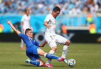 Marco Verratti of Italy tackles Cristian Rodriguez of Uruguay