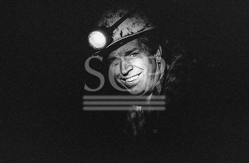 Velenje, Slovenia. Coal miner with helmet torch; RLV Mine. Black and White.