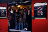 Paris, France.November 15, 2007..RER trains at Gare Du L'Est were rare on a nationwide day of strikes. Commuters pack trains at rush hour to head home. Many tracks remain empty. French unions continue an open-ended strike in public transport (SNCF, RATP, ...), yet most workers at the EDF electricity and GDF gas utilities returned to work after taking action the previous day, in a major test for President Nicolas Sarkozy's reform plans. They are protesting against the scrapping of pension privileges that allow some public employees to retire as early as age 50...