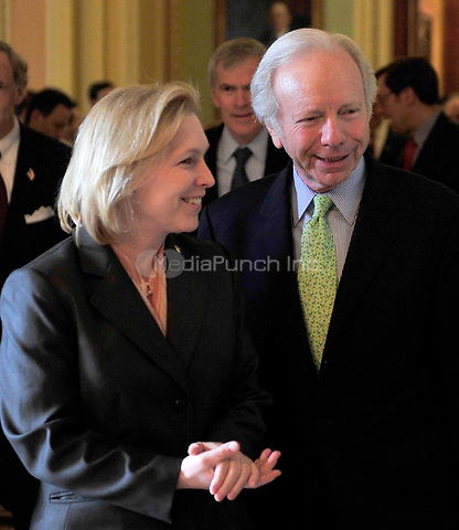 Washington, D.C. - March 25, 2010 -- United States Senators Kirsten Gillibrand (Democrat of New York), left, and Joseph Lieberman (Independent Democrat of Connecticut), right, walk through the U.S. Capitol after the U.S. Senate passed its version of the health care reform bill on Thursday, March 25, 2010.  .Credit: Ron Sachs / CNP/MediaPunch