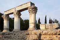 A detail of Temple E, on April 16, 2007 in Corinth, Greece. Originally built during the early Augustan period, 1st century BC, Temple E was rebuilt after the earthquake of 77 AD. These three fine Corinthian capitals and columns, two of which have been reconstructed, standing on a raised stone terrace, are seen in the early morning light. Corinth, founded in Neolithic times, was a major Ancient Greek city, until it was razed by the Romans in 146 BC.