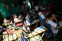 Cuban children have a class in a small basic school in the Old Havana, Cuba, 11 February 2009. About 50 years after the national rebellion, led by Fidel Castro, and adopting the communist ideology shortly after the victory, the Caribbean island of Cuba is the only country in Americas having the communist political system. Although the Cuban state-controlled economy has never been developed enough to allow Cubans living in social conditions similar to the US or to Europe, mostly middle-age and older Cubans still support the Castro Brothers' regime and the idea of the Cuban Revolution. Since the 1990s Cuba struggles with chronic economic crisis and mainly young Cubans call for the economic changes.