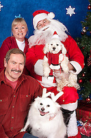 Dogs are photographed with Santa at a fundraiser for Dogs Deserve Better at Pet Pros in Redmond, WA on December 12, 2010. (photo by Karen Ducey)Dani and Bliss are photographed with their parents, Joe and Sally, with Santa at a fundraiser for Dogs Deserve Better at Pet Pros in Redmond, WA on December 12, 2010. (photo by Karen Ducey)